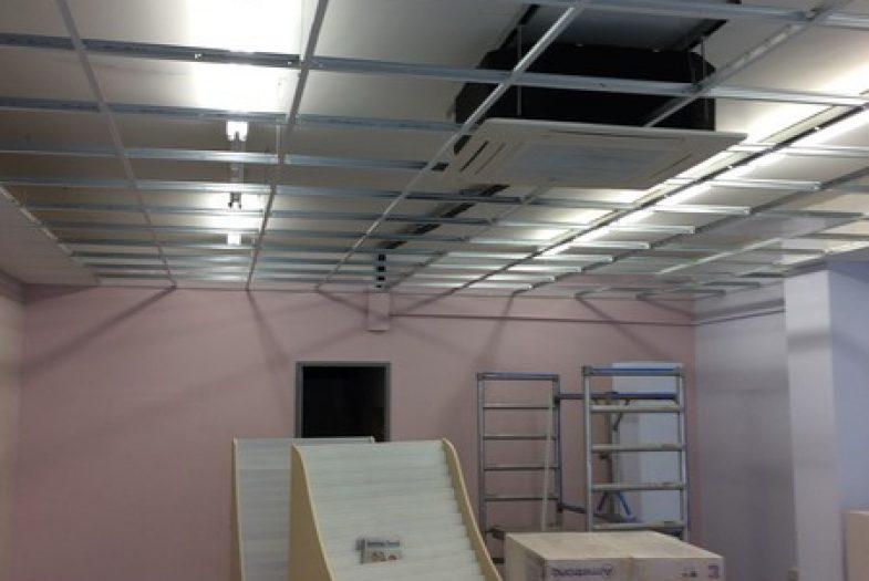 Drop ceiling grid installation in progress